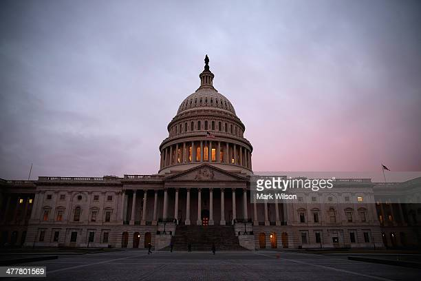 The American Flag flies over the Senate side of the US Capitol as Senate Democrats speak nonstop on the chamber floor about climate change on March...