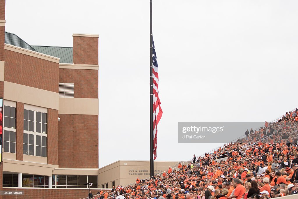 The American flag hangs at half mast for those killed in a car crash at the homecoming parade during the second quarter of a NCAA college football...