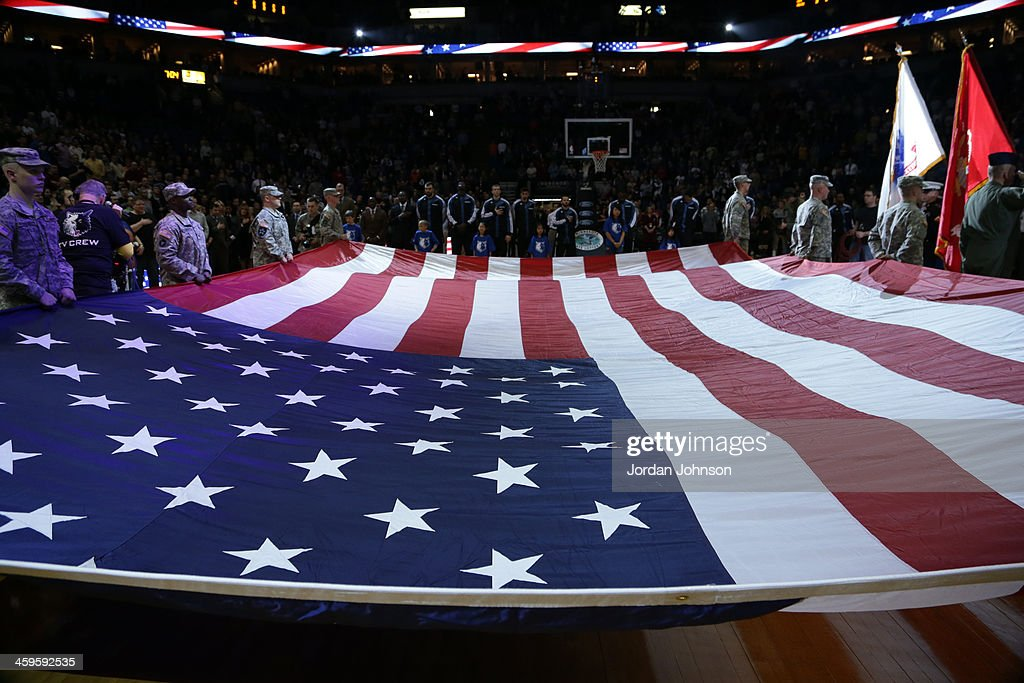 The American Flag is displayed during the Cleveland Cavaliers against the Minnesota Timberwolves on November 13, 2013 at Target Center in Minneapolis, Minnesota.