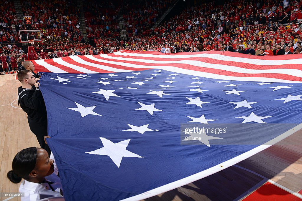 The American flag is displayed during the national anthem before the game between the Maryland Terrapins and the Florida State Seminoles at the Comcast Center on January 9, 2013 in College Park, Maryland.