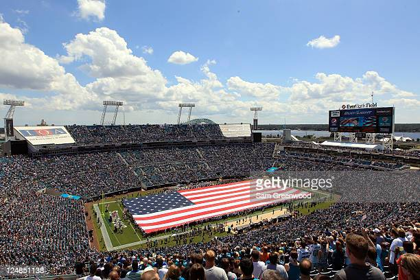 The American flag is displayed on the field before the start of the season opener game between the Jacksonville Jaguars and the Tennessee Titans at...