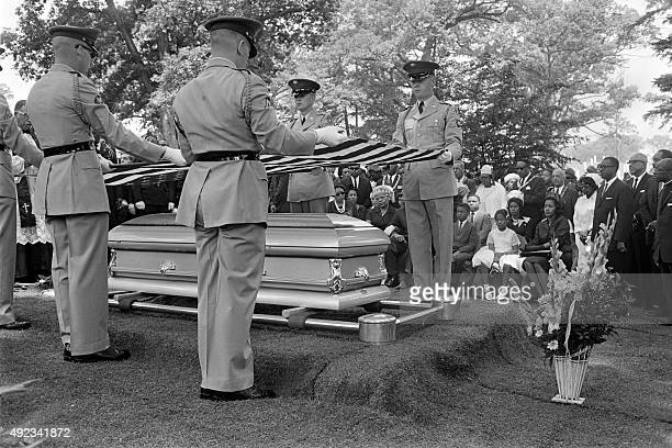 The American flag is held over the coffin of American civil rights activist Medgar Evers during his funeral on June 20 1963 in Arlington National...