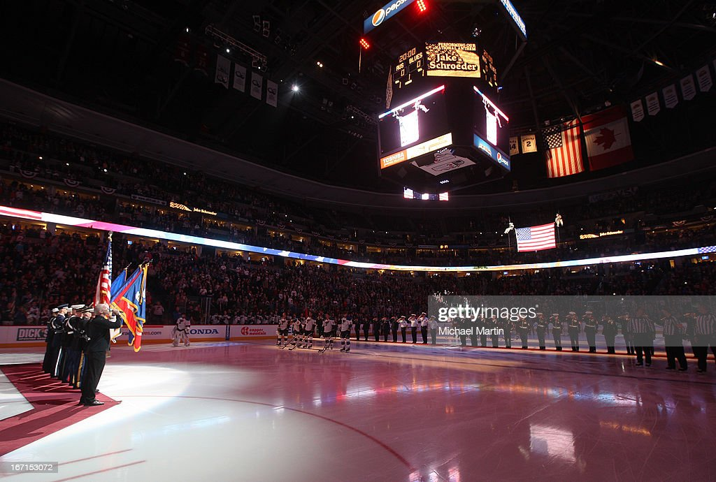 The American Flag is lowered from the rafters during the National Anthem prior to the game of the Colorado Avalanche skates against the St Louis Blues at the Pepsi Center on April 21, 2013 in Denver, Colorado.