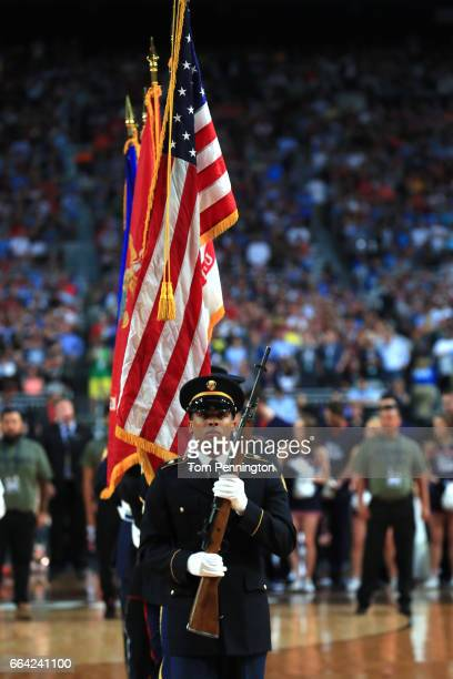 The American flag is presented during the national anthem before the game between the North Carolina Tar Heels and the Gonzaga Bulldogs during the...