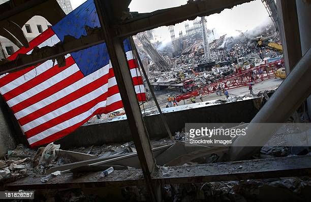 The American Flag is prominent amongst the rubble of what was once the World Trade Center.