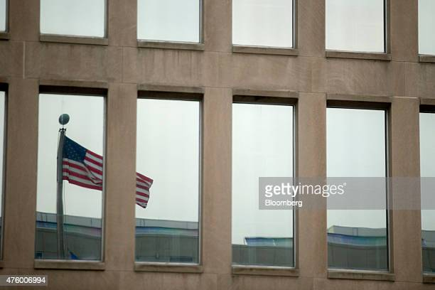 The American flag is reflected in a window at the Theodore Roosevelt Building headquarters of the US Office of Personnel Management in Washington DC...