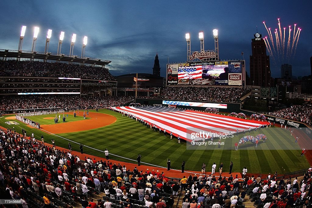 The American flag is seen on the field during the National Anthem prior to the start of Game Three of the American League Championship Series between...