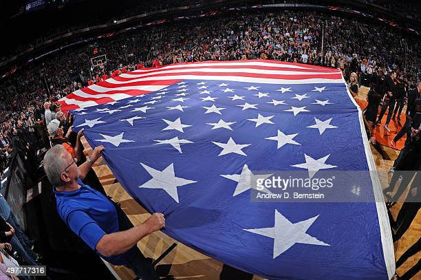 The American flag is stretched across the floor before the Los Angeles Clippers play against the Phoenix Suns at Talking Stick Resort Arena on...