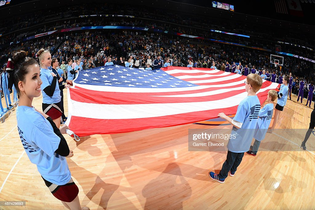 The American flag is stretched out on the court before the Los Angeles Lakers game against the Denver Nuggets on November 13, 2013 at the Pepsi Center in Denver, Colorado.