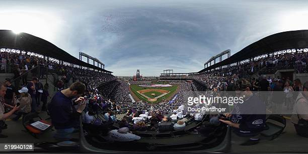 The American Flag is unfurled as the national anthem is observed prior to the San Diego Padres facing the Colorado Rockies during opening day at...