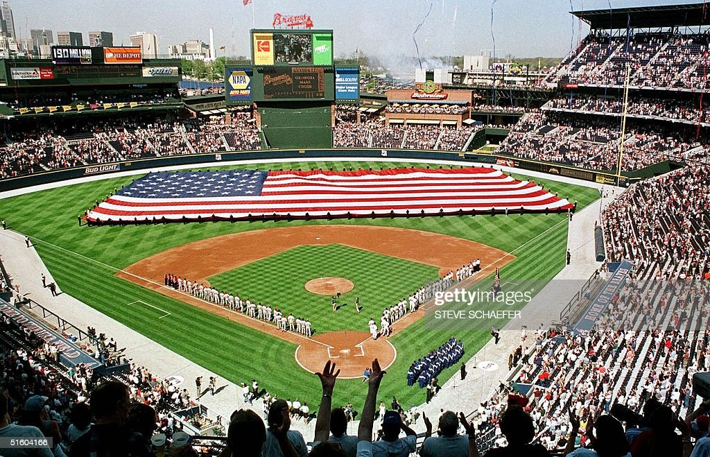 The American flag is unfurled during the opening ceremonies before the start of the Atlanta Braves and Philadelphia Phillies game at Turner Field in...