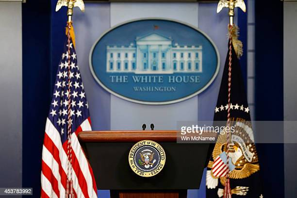 The American flag sits next to a empty speaker podium before US President Barack Obama gives a statement during a press conference in the Brady Press...