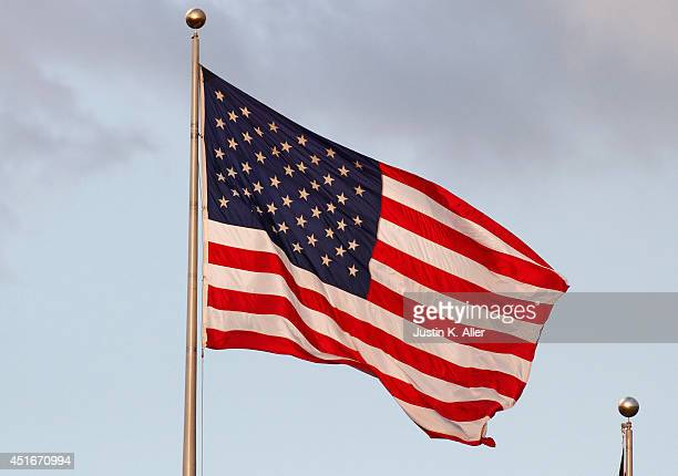 The American flag waves during the game between the Arizona Diamondbacks and the Pittsburgh Pirates at PNC Park on July 3 2014 in Pittsburgh...
