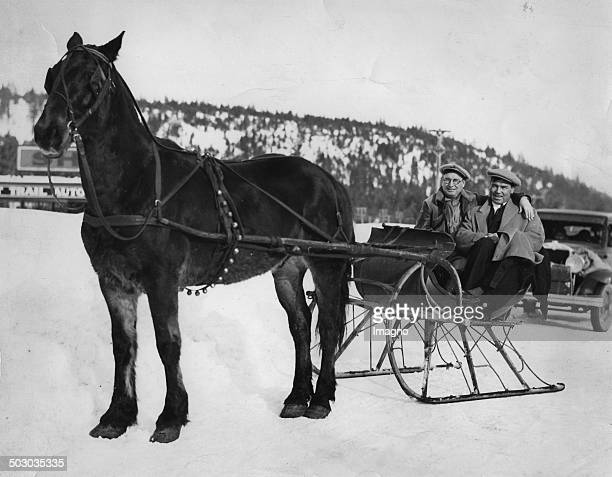 The American football player Jack McKay and the American boxer Jack Dempsey in a sleigh Truckee / Nevada 29th January 1932 Photograph