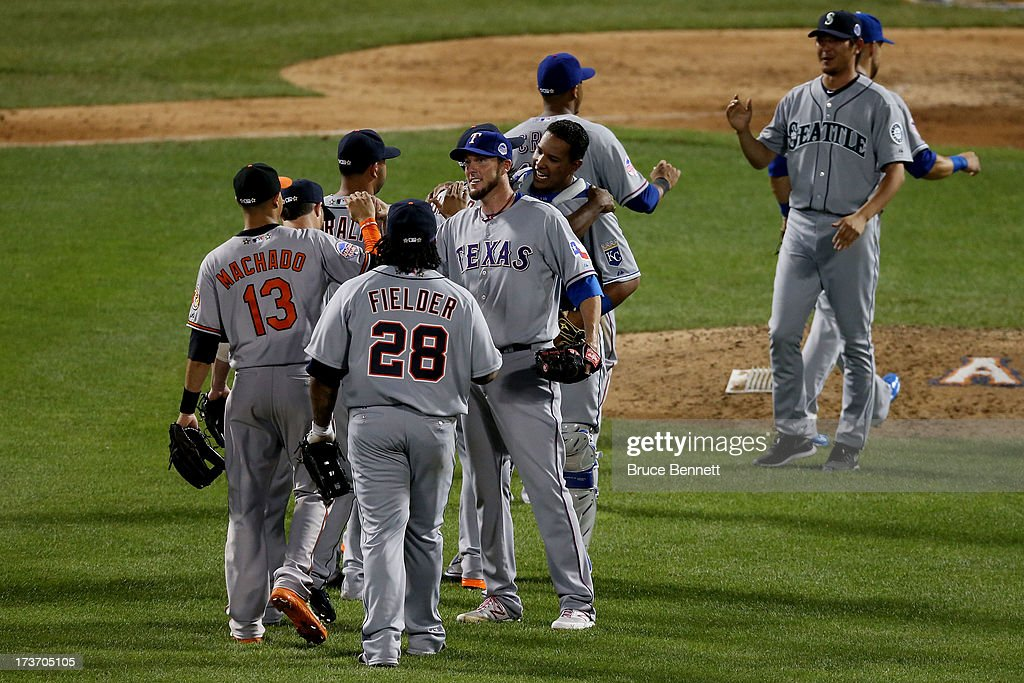 The American League All-Star team celebrates their 3-0 win in the 84th MLB All-Star Game on July 16, 2013 at Citi Field in the Flushing neighborhood of the Queens borough of New York City.