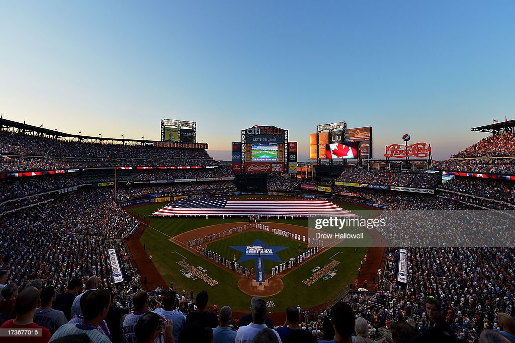 The American National Athem is sung as the flag covers the field before the 84th MLB All-Star Game on July 16, 2013 at Citi Field in the Flushing neighborhood of the Queens borough of New York City.
