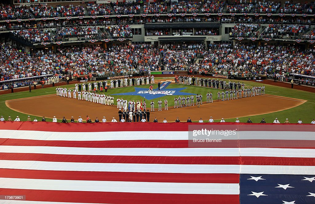 The American National is sung as the flag covers the field before the 84th MLB All-Star Game on July 16, 2013 at Citi Field in the Flushing neighborhood of the Queens borough of New York City.