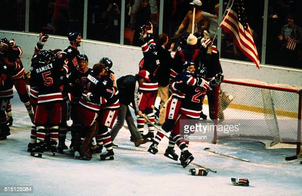 The American Olympic ice hockey team celebrates on the ice after defeating Finland 42 in the final game and winning the gold medal in the 1980...