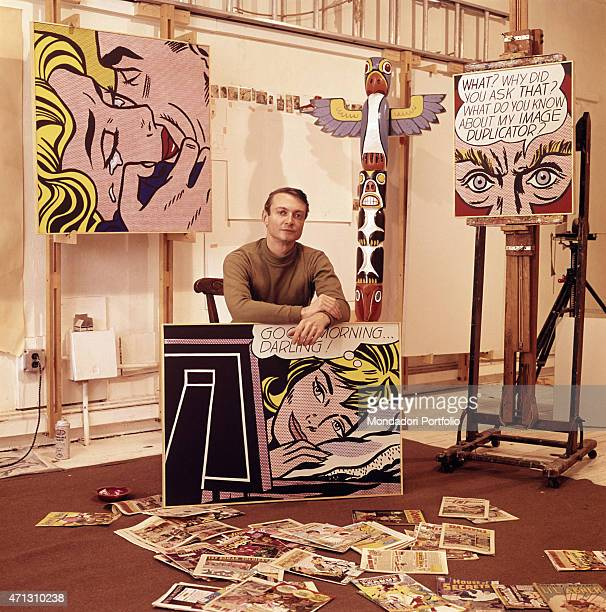 The American painter and representative of Pop Art Roy Lichtenstein poses confidently among some of his works 1964