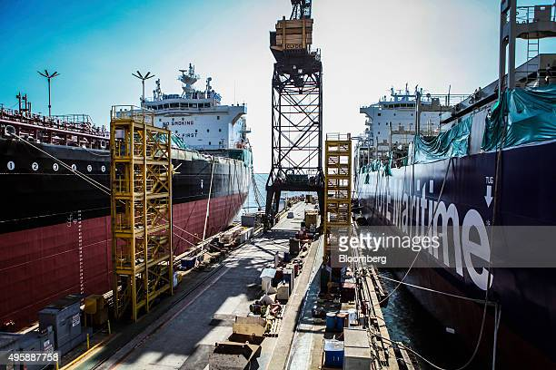 The American Petroleum Tankers' Lone Star State ship left and Tote Inc ship sit docked while under construction at the General Dynamics NASSCO...