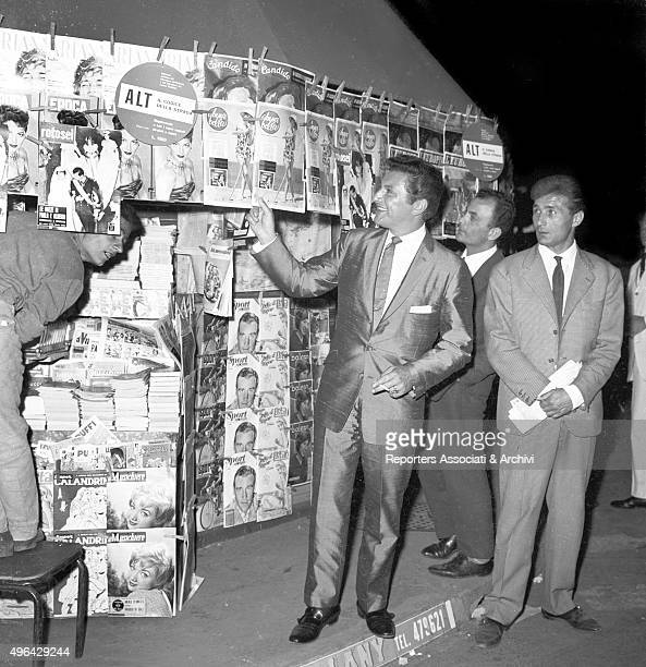 The American pianist and entertainer Liberace beside a newsstand in Via Veneto Rome 1959