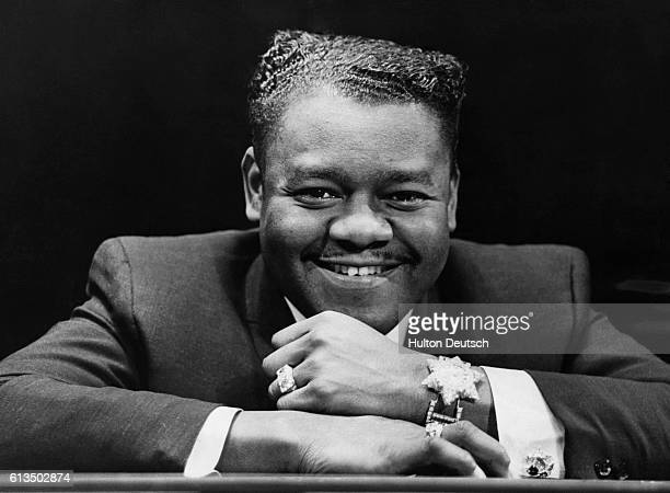 The American pianist band leader and blues singer Fats Domino His hits include Ain't it a shame and Blue Monday