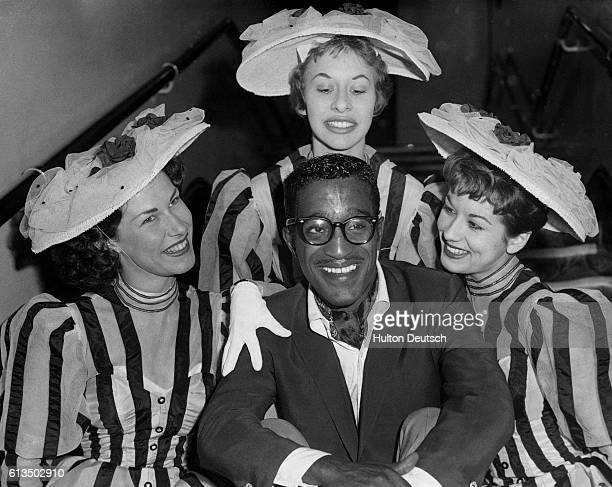 The American singer actor and dancer Sammy Davis Jr with three members of The Silhouettes during the dress rehearsal for the 1960 Royal Variety...