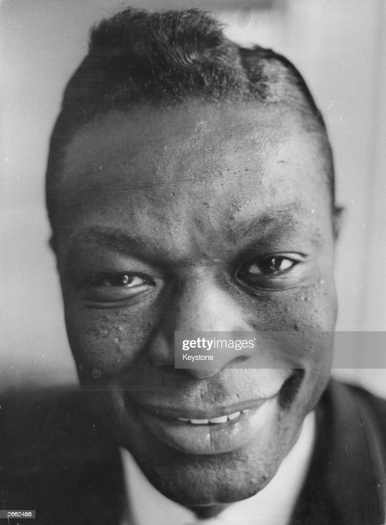 The American singer <a gi-track='captionPersonalityLinkClicked' href=/galleries/search?phrase=Nat+King+Cole&family=editorial&specificpeople=217991 ng-click='$event.stopPropagation()'>Nat King Cole</a> (1919 - 1965) on tour in London.
