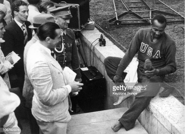 The American Sprinter Jesse Owens In Berlin On August 3 After His First Place Finish In The 200M At The Olympic Games Jesse Owens Won The Gold Medal...