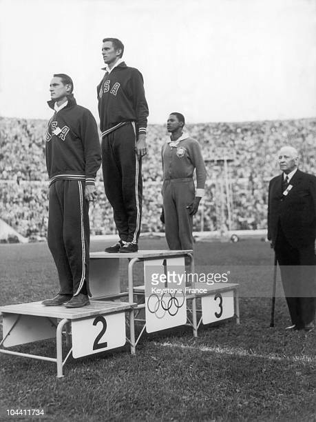 The Americna KWIESNER second his compatriot GDAVIS first and the Brazilian Telles da CONCEICAO third on the podium of the high jump event at the...