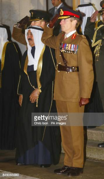 The Amir of the State of Kuwait His Highness Sheikh Sabah AlAhmad AlJaber AlSabah takes the salute beside the Commandant Major General Tim Evans...