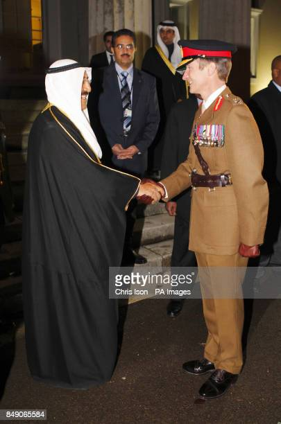 The Amir of the State of Kuwait His Highness Sheikh Sabah AlAhmad AlJaber AlSabah shakes hands with the Commandant Major General Tim Evans during a...