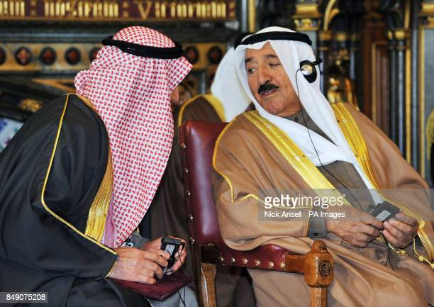 The Amir of the State of Kuwait His Highness Sheikh Sabah AlAhmad AlJaber AlSabah speaks to an aide in the Royal Robing Room during a visit to the...