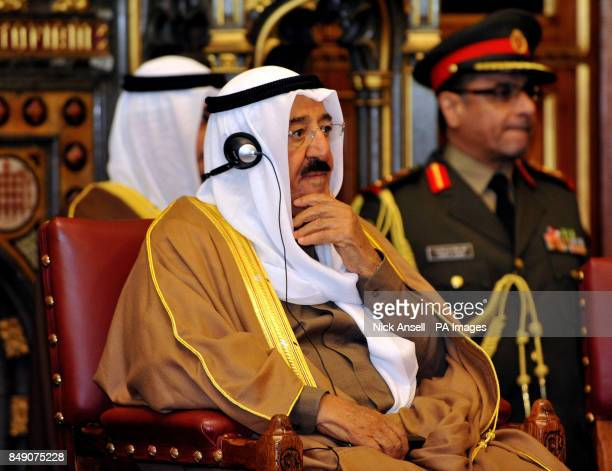 The Amir of the State of Kuwait His Highness Sheikh Sabah AlAhmad AlJaber AlSabah listens on a headset as the Speaker of the House of Commons John...