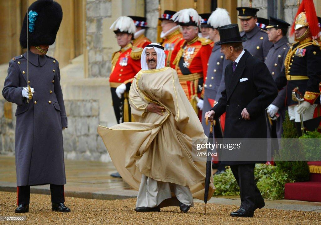 The Amir Sheikh Sabah AlAhmad AlJaber AlSabah of Kuwait walks to inspect the troops with Prince Philip Duke of Edinburgh at Windsor Castle during a...