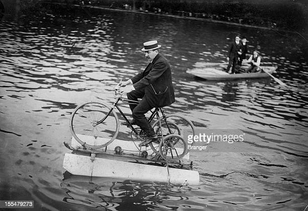 The 'amphibocycle' water bicycle on the river Seine Asnières 1909