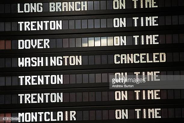 The Amtrak information board shows the Washingtonbound train from New York as cancelled after an Amtrak train derailed in Philadelphia last night on...
