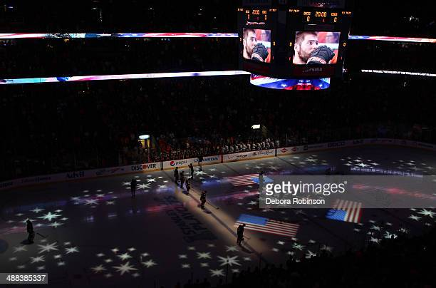 The Anaheim Ducks and the Los Angeles Kings stand during the national anthem in the Second Round of the 2014 Stanley Cup Playoffs at Honda Center on...