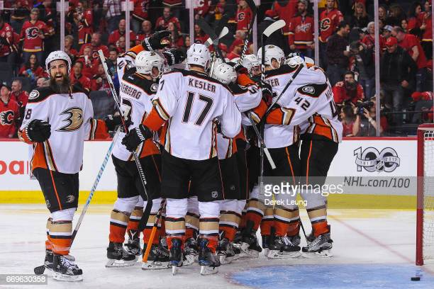 The Anaheim Ducks celebrate after defeating the Calgary Flames in overtime in Game Three of the Western Conference First Round during the 2017 NHL...