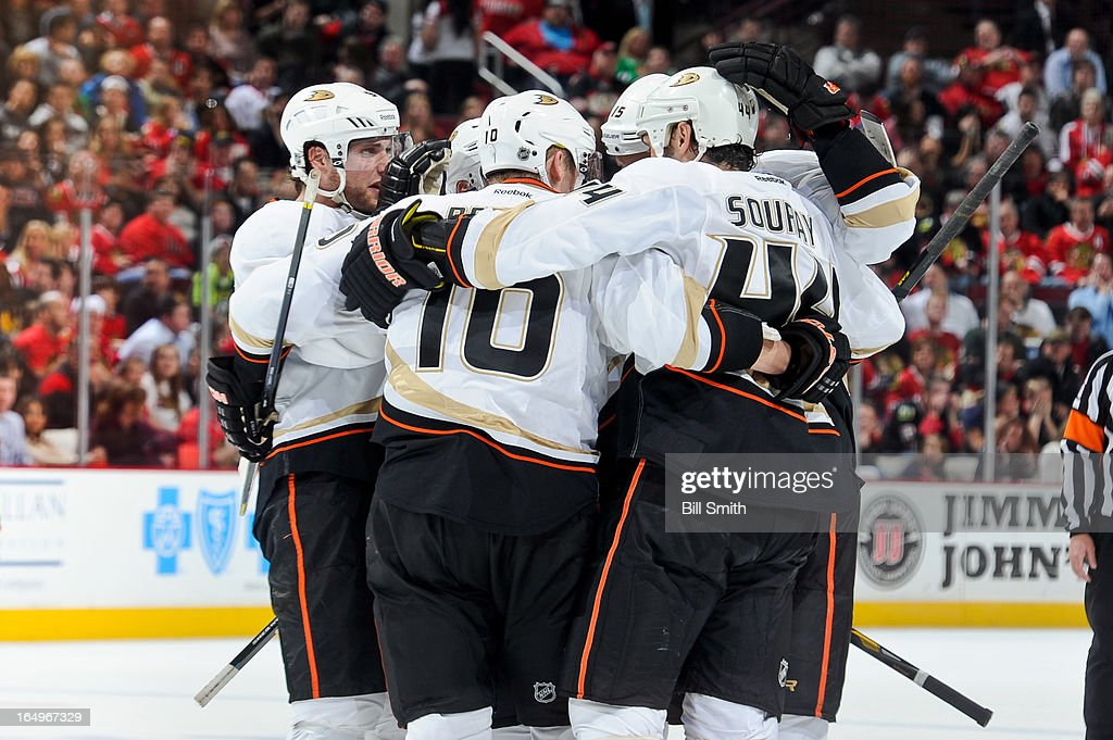 The Anaheim Ducks celebrate, including Bobby Ryan #9, after scoring against the Chicago Blackhawks in the third during the NHL game on March 29, 2013 at the United Center in Chicago, Illinois.