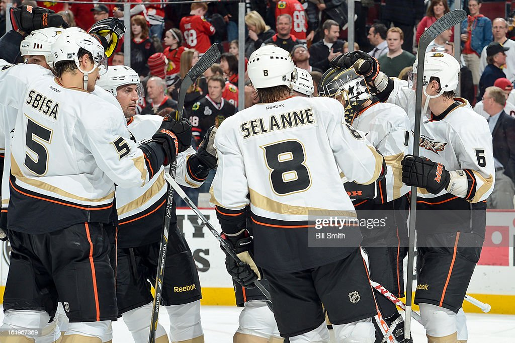 The Anaheim Ducks celebrate, including <a gi-track='captionPersonalityLinkClicked' href=/galleries/search?phrase=Francois+Beauchemin&family=editorial&specificpeople=604125 ng-click='$event.stopPropagation()'>Francois Beauchemin</a> #23, with goalie <a gi-track='captionPersonalityLinkClicked' href=/galleries/search?phrase=Jonas+Hiller&family=editorial&specificpeople=743364 ng-click='$event.stopPropagation()'>Jonas Hiller</a> #1, after the Ducks defeated the Chicago Blackhawks 2-1 during the NHL game on March 29, 2013 at the United Center in Chicago, Illinois.