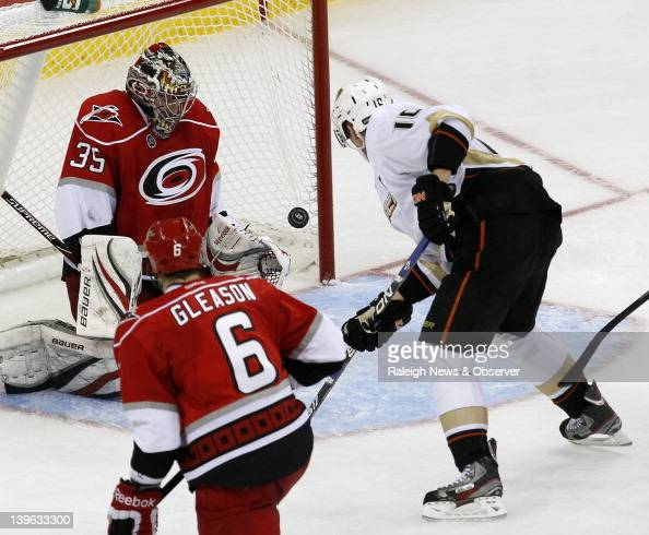 The Anaheim Ducks' Corey Perry puts the puck past Carolina Hurricanes goalie Justin Peters to tie the game in the third period at the RBC Center in...