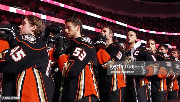 The Anaheim Ducks line up for the Canadian national anthem prior to the game against the Vancouver Canucks on April 1 2016 at Honda Center in Anaheim...