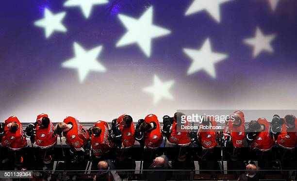 The Anaheim Ducks listen to the national anthem from the bench prior to their game against the Pittsburgh Penguins on December 6 2015 at Honda Center...