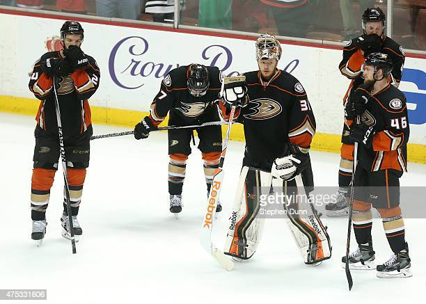 The Anaheim Ducks stand on the ice after losing to the Chicago Blackhawks 53 in Game Seven of the Western Conference Finals during the 2015 NHL...