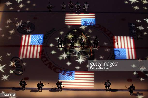 The Anaheim Ducks stands on the during the singing of the National Anthem before the game against the San Jose Sharks on March 28 2012 at Honda...