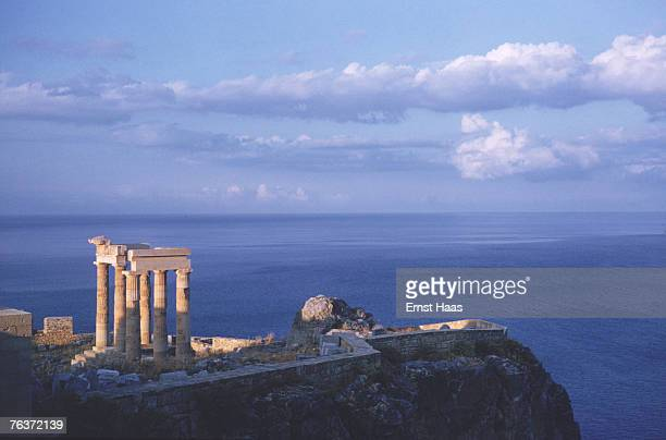 The ancient Greek acropolis of Lindos on the island of Rhodes 1960 These few remaining pillars were once part of a large Hellenistic stoa or portico