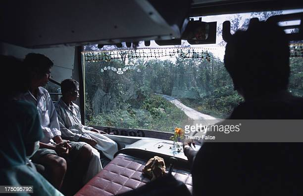 The Andaman Trunk Road which runs alongside Jarawas territory seen from a public bus