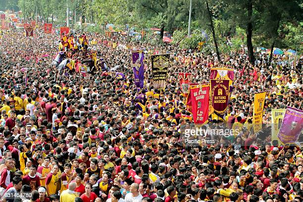 AVE MANILA NCR PHILIPPINES The andas of the Black Nazarene can bee seen with a sea of humanity surrounding it along Padre Burgos Avenue in Manila The...