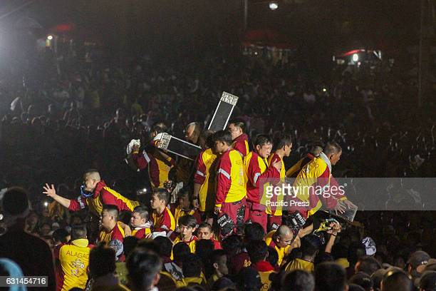 GRANDSTAND MANILA NCR PHILIPPINES The andas of the Black Nazarene is seen with a sea of humanity surrounding it with thousand upon thousand of...